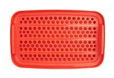 Envase de comida plástico rojo aislado sobre el fondo blanco Foto de archivo