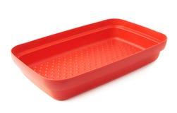 Envase de comida plástico rojo aislado sobre el fondo blanco Fotos de archivo