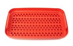 Envase de comida plástico rojo aislado sobre el fondo blanco Fotos de archivo libres de regalías
