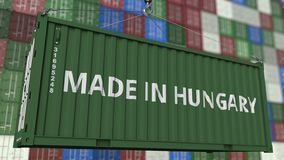Envase del cargamento con HECHO EN el subtítulo de HUNGRÍA Representación relacionada húngara 3D de la importación o de la export stock de ilustración