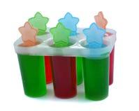 Envase del cubo de hielo del color Imagenes de archivo