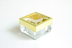 Envase transparente con el casquillo de oro Imagen de archivo