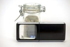 Envase y lupa de la especia Foto de archivo libre de regalías