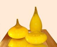 Envases de cristal decorativos amarillos Fotos de archivo