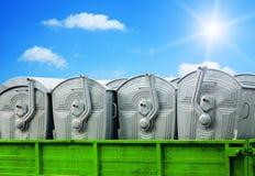 Envases de la basura en fondo del cielo azul Fotografía de archivo