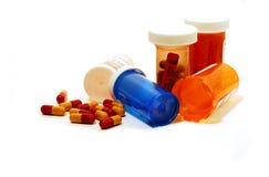 Envases de las píldoras blancos Fotografía de archivo libre de regalías