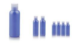 Envases de plástico azules Imagenes de archivo