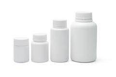 Envases de plástico en blanco Imagen de archivo libre de regalías