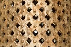 Envases decorativos redondos grandes con los pernos prisioneros y las perforaciones rectangulares Foto de archivo libre de regalías