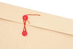 Envelop met rood koord stock afbeeldingen