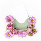 Envelop with pink flowers frame. Flat lay. Top view Royalty Free Stock Photography