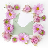 Envelop with pink flowers frame. Flat lay. Top view Stock Photography