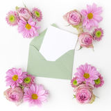 Envelop with pink flowers frame. Flat lay. Top view Royalty Free Stock Photos