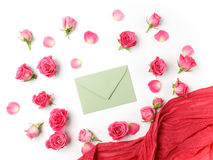 Envelop with scarf and rose background. Flat lay, top view. Royalty Free Stock Images
