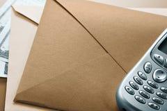 Envelop, telefoon, dollars Royalty-vrije Stock Foto's
