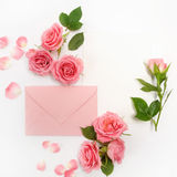 Envelop With White Card And Rose Background. Top View. Flat Lay
