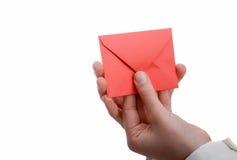 Envelope à disposição Fotografia de Stock