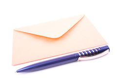 Envelope. Close-ups of orange envelope and pen isolated on white stock image
