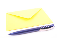 Envelope. Close-ups of yellow envelope and pen isolated on white royalty free stock image