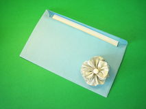 Envelope. And silver ribbon isolated on green background Stock Photos