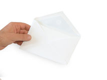 Envelope. Hand and envelope on white background royalty free stock image