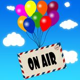 Envelope with ON AIR message attached to multicoloured balloons on blue sky and clouds background. Illustration Stock Photo