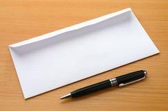 Envelope And Ball Pen Stock Photos