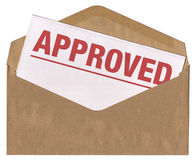 Envelope - Approved notice letter. Brown envelope containing letter with approved statement Stock Photography