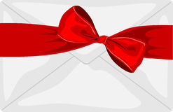 Envelope with a big red bow and ribbon Royalty Free Stock Image