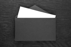 Envelope on a black wooden table Stock Photo