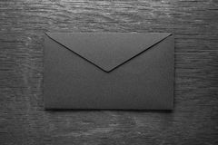 Envelope on a black wooden table Royalty Free Stock Photo