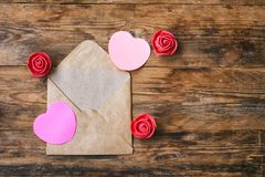 Valentine`s day composition, envelope with blank note, heart sha Royalty Free Stock Image