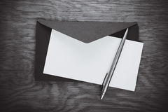 Envelope with blank and pen Stock Photo