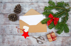Envelope with blank sheet of paper on Christmas background Stock Photos