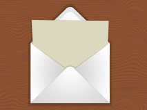 Envelope with blank. Template for business in the form of an envelope with a blank sheet on wooden table background royalty free illustration