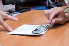 Envelope with a bribe. The transfer of an envelope with a bribe Royalty Free Stock Images