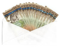 Envelope with Canadian one hundred dollar bills. Envelope with fanned out Canadian one hundred dollar bills Stock Photos
