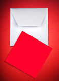 Envelope and card on red Royalty Free Stock Photography