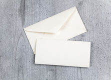 Envelope and card on wood background Stock Photos