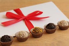 Envelope and chocolates Stock Photo