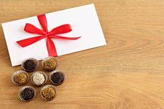 Envelope and chocolates Stock Image