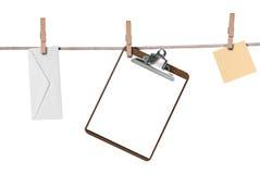 Envelope,clipboard on a clothe Stock Photos