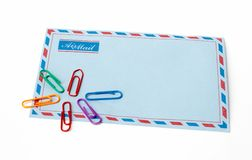 Envelope and clips. In isolated background royalty free stock image