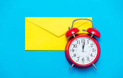 Envelope and clock Stock Images