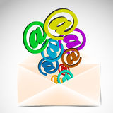 Envelope with colorful at signs Royalty Free Stock Image
