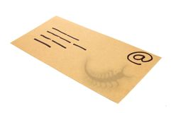 Envelope, concept for email with a virus infected attachment. Manila Envelope used as a concept for email with the shadow of a bug (virus) attachment Royalty Free Stock Photo