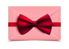 Envelope with decorative red bow Stock Photos