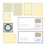Envelope and different shapes of stamps Royalty Free Stock Photo