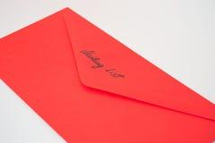 Envelope do vermelho da lista de endereços Fotografia de Stock