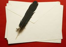 Envelope with feather Royalty Free Stock Photos